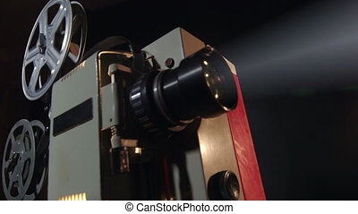 Old flickering movie projector showing film