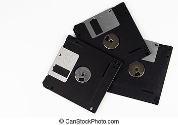 Old floppy disks on a white background.