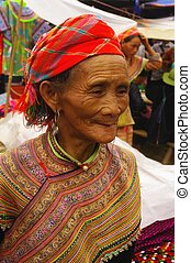 Old Flowered Hmong woman - An old woman in the market of Can...