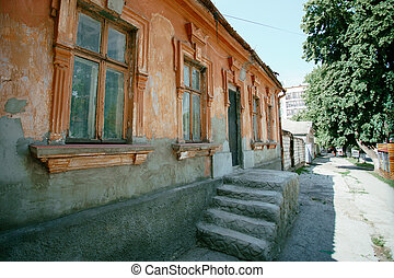 old forgotten traditional colored house in the city