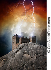 Old fortress on rock struck by lightning from dark red sky