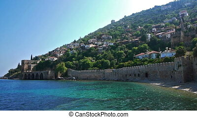 Old fortress wall on sea shore in Alanya, Turkey