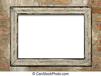 old frame on brick wall