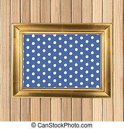 Old frame on wooden background