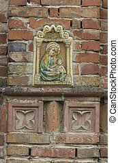old frame with Madonna on wall