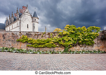 Old French castle on dramatic sky background