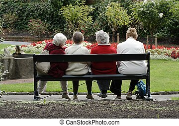 Four old ladies having a wonderful day out at the park in their retirement