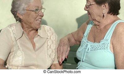 Old friends, two happy senior women