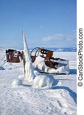 Old frozen ship on the bank of Olkhon island on siberian lake Baikal at winter