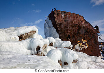 Old frozen ship on the bank of Olkhon island on siberian lake Baikal at winter time