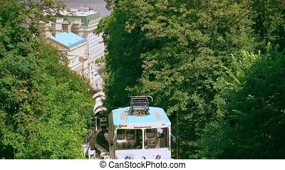 old funicular runs the street - blue railway carriage goes...