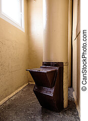 Old garbage chute in apartment building with cheap apartments - Rubbish chute in a Soviet block of flats