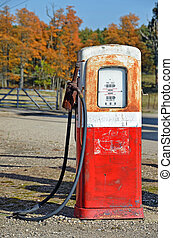 Old Gas Pump - Old gas pump with autumn trees.