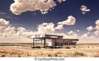 Old gas station in ghost town along the route 66 at border...