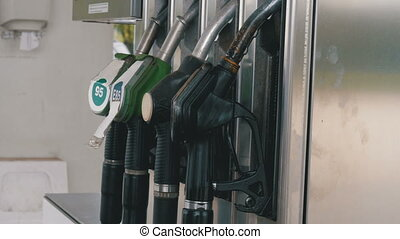 Old Gasoline or petrol station gas fuel pump nozzle. Filling station. Petrol station