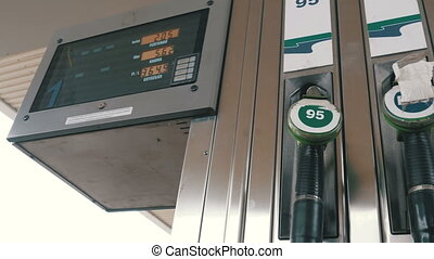 Old Gasoline or petrol station gas fuel pump nozzle. Filling...