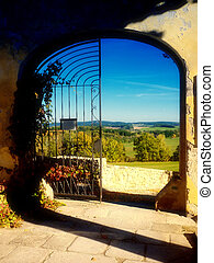 Old gate with nice wiev - Detail of an old gate wit ...