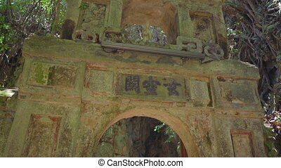 Old gates to the biggest cave in The Marble mountains a complex of Buddhist temples, a famous tourist destination in the city of Da Nang, central Vietnam. Travel to Vietnam concept.