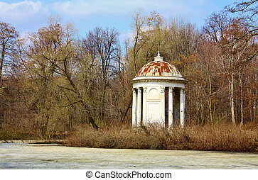 Old gazebo in the spring forest