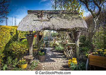 Old gazebo with thatched roof