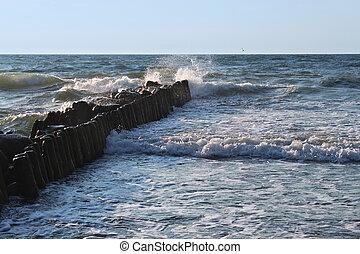 Old german breakwater on the Baltic Sea coast at summer.