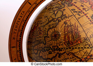 old brown globe with many different counties