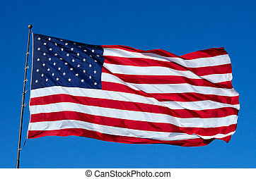 Old Glory in the Wind - Old glory is proudly waving in the...