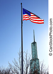 Old Glory. - Old glory against a sunny sky and the...