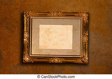 old gold antique picture frame on the dark wall