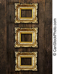 Old Gold Picture Frames on wooden wall