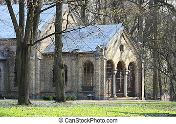 Old gothic church on abandoned Pokrov cemetery in Riga,...