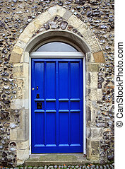 Gothic style door in a flint wall in the historic city of norwich, norfolk
