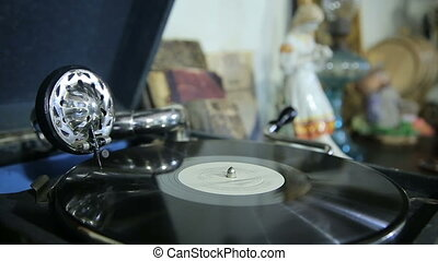 Old gramophone playing vinyl record