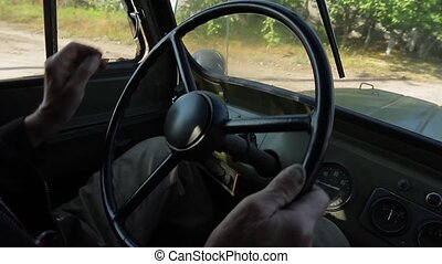 Old grandfather goes on a retro pickup truck.