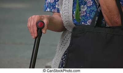 Old grandma with a cane stick.