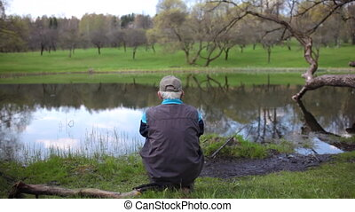 old grandpa goes fishing in river