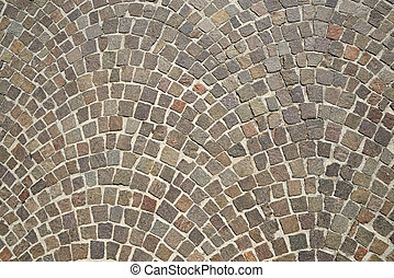 Old granite cobblestone pavement background