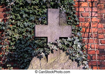 Bytom, Poland - old grave made of stone, covered in ivy