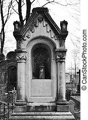 Old grave on Nikolskoye cemetery, St.Petersburg, Russia. Black and white