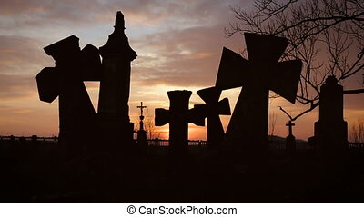 Old Graveyard with Ancient Crosses on Sunset