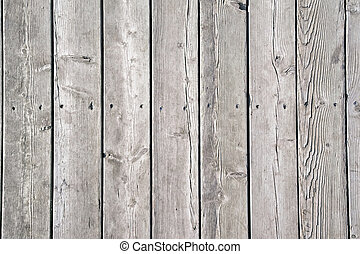 Old gray wooden planks with holes from nails