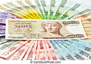 old greek drachma and euro cash banknotes. greece euro crisis concept