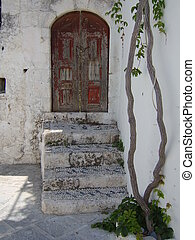 Old Greek House - Old Greek house with weathered door and...