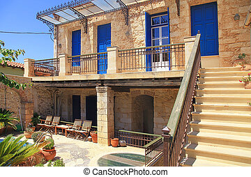 old Greek house with blue doors and windows, Crete