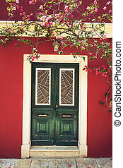 Old greek house with flowers of bougainvillea