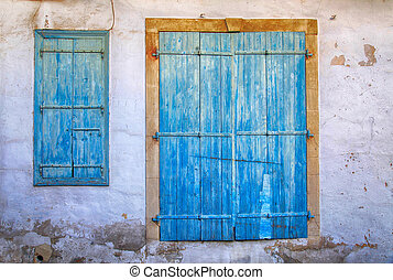 Old blue weathered door and window in Cyprus