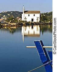 Old Greek orthodox church by the sea at Corfu, Greece