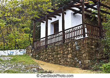 Old Greek traditional wood-stone house near Edessa city in ...