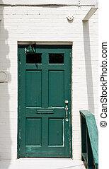 Old Green Door on White Brick Walll
