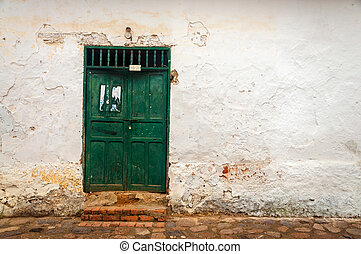 Old Green Door with White Wall